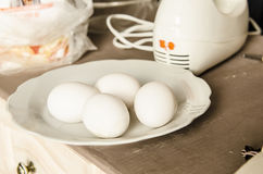 White eggs on plate Stock Image