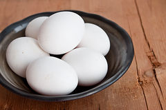 White eggs in rustic bowl Stock Photos