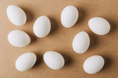 White eggs scattered. On brown carton stock photo