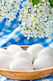 White eggs and spring flowers Stock Photo