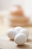 White eggs on the table. White eggs on the wooden table Stock Images