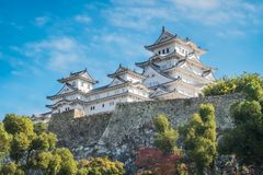 White Egret Castle on a beautiful day in autumn in Japan. Himeji Castle is the most spectacular castle in all of Japan. The castle, shown her in autumn is also royalty free stock photos