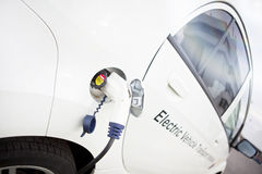 White Electric Car Charging Outdoor Royalty Free Stock Photos