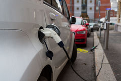 White electric car charging Royalty Free Stock Photos