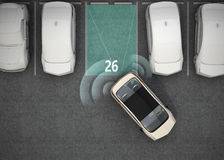 White electric car driving into parking lot with parking assist system Royalty Free Stock Image