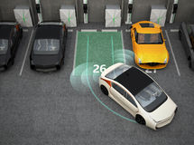White electric car driving into parking lot with parking assist system Royalty Free Stock Photos