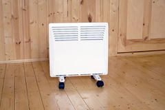 White electric con heater in wooden house Stock Photography