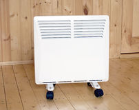 White electric con heater in wooden house Royalty Free Stock Images