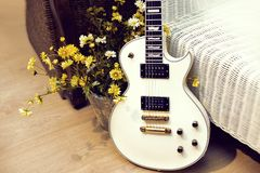 White  electric guitar with flowers Stock Images