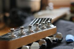 White electric guitar head tune close up. Head tune of electric guitar close up, ready for playing a song with guitar Royalty Free Stock Image