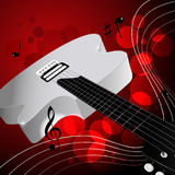 White electric guitar. Whitte electric guitar on the red background Royalty Free Stock Photography