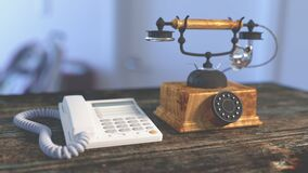 White Electric Home Phone Close to Rotary Phone on Table Royalty Free Stock Photos