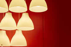 White electric lamps in red background for sale Stock Photos