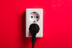 White electric socket on the wall. stock photo