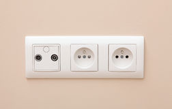 White electric socket on the wall. Royalty Free Stock Photo