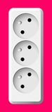 White electric triple socket. White realistic electric triple socket on color background Stock Image