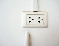 White electrical socket. On a white wall royalty free stock image