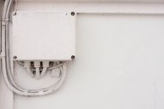 White electronic box. The electronic box on the wall, white color electronic box on the wall Royalty Free Stock Photo