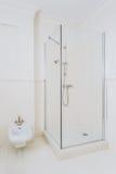 White elegant shower room. White modern elegant shower room in luxurious house stock photo