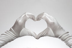 White elegant womens heart shaped gloves isolated on white background Royalty Free Stock Photography