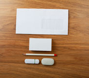 The white elements of corporate identity on a wooden background. Template for business cards template for placement of the logo royalty free stock photography