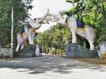 White elephant sculpture hold the dhamma wheel stock photos