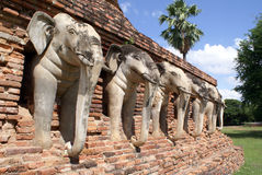 White elephants and red bric pagoda Royalty Free Stock Photography