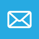 White email button icon. On a blue background Royalty Free Stock Photography
