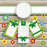 White Emblem Easter Price Stickers Wood Flowers. Easter price stickers on the wooden background Stock Images