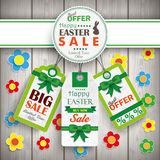 White Emblem Easter Price Stickers Wooden Wall Flowers. Easter price stickers on the wooden background Royalty Free Stock Photo