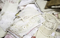 White Embroidered Cloths. With lace in clothing store, retales Stock Image