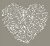 White embroidered lace heart with floral swirls Royalty Free Stock Image
