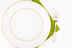 White Empry Plate on a Tablecloth with Place for Your Text Royalty Free Stock Photography