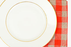 White Empry Plate on a Tablecloth with Place for Your Text Royalty Free Stock Images