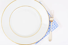 White Empry Plate on a Tablecloth with Place for Your Text Stock Photos