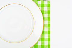 White Empry Plate on a Tablecloth with Place for Your Text Royalty Free Stock Photos