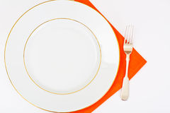 White Empry Plate on a Tablecloth with Place for Your Text Stock Photo