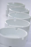 White empty ashtrays. The white pure ashtrays constructed in a number Stock Image