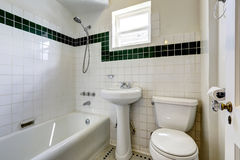 White empty bathroom with small window Royalty Free Stock Photography