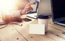 White Empty Business Card Mockup Wood Table Take Away Coffee Cup.Adult Businessman Work Modern Notebook Office Blurred Royalty Free Stock Photo