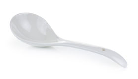 White empty ceramic spoon on white background Stock Photo