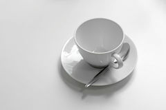 White empty coffee cup and spoon Stock Photos