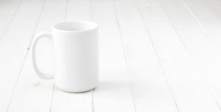 White empty cup on white table Royalty Free Stock Images