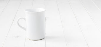 White empty cup on white table stock photography