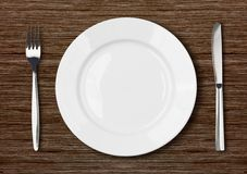 White empty dinner plate setting on dark wooden royalty free stock images