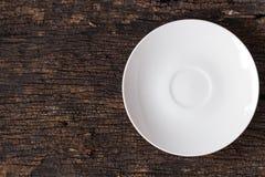 White empty dish on wood royalty free stock image