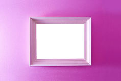 White empty frame on the pink wall. Stock Photos