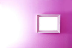 White empty frame on the pink wall. Royalty Free Stock Photo