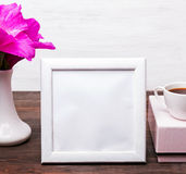 White empty frame with place for text on the table Stock Image