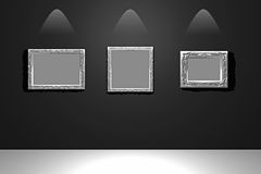 White empty frames. On the black lightened wall stock illustration